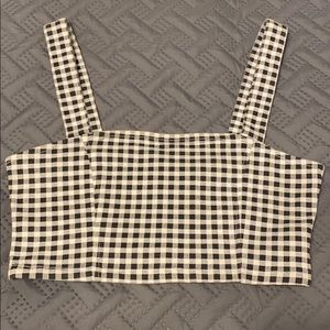 A black and white checkered cropped top